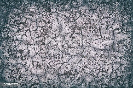 High contrast, textured concrete wall background with vignette.