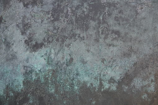 Turquoise and gray textured metal surface background.