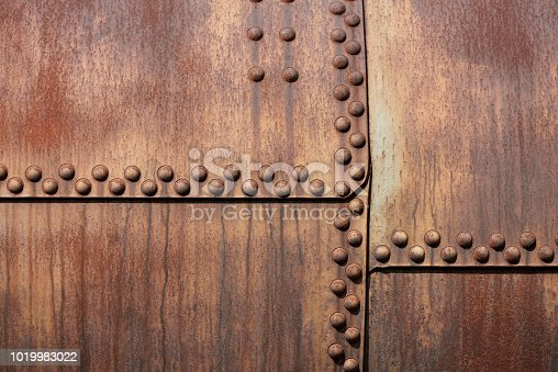 Weathered metal background with rivets, part of an old tank wagon.