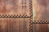High Resolution photograph of a weathered metal surface with rivets
