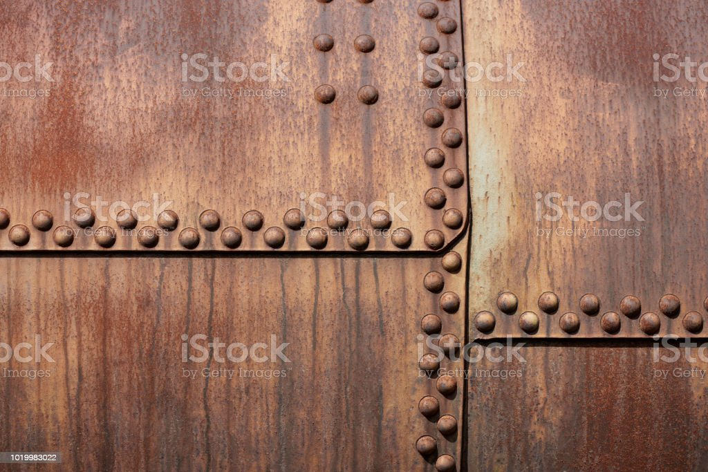 High Resolution photograph of a weathered metal surface with rivets stock photo