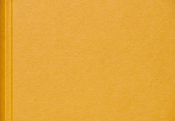 High resolution photograph of a yellow linen book cover stock photo