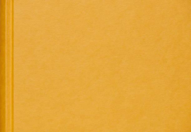 Hochauflösendes Foto eines gelben Leinenbuchdeckels – Foto