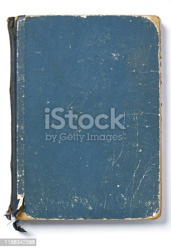 istock High resolution photograph of an very old blue paperback book 1188342388