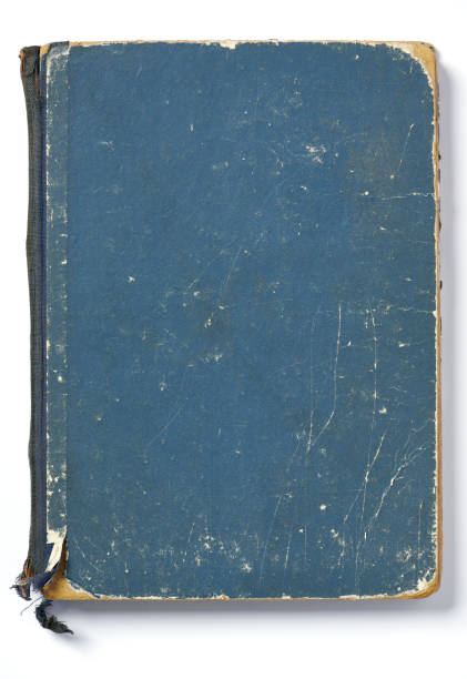 High resolution photograph of an very old blue paperback book stock photo