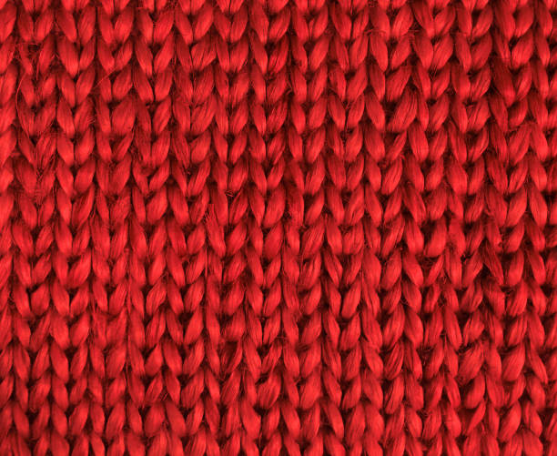 High Resolution Red Knitted Fabric Close up High Resolution Red Knitted Fabric Close up merino sheep stock pictures, royalty-free photos & images