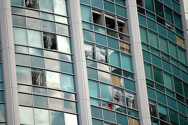 High rise building with damaged and missing window panes stock photo