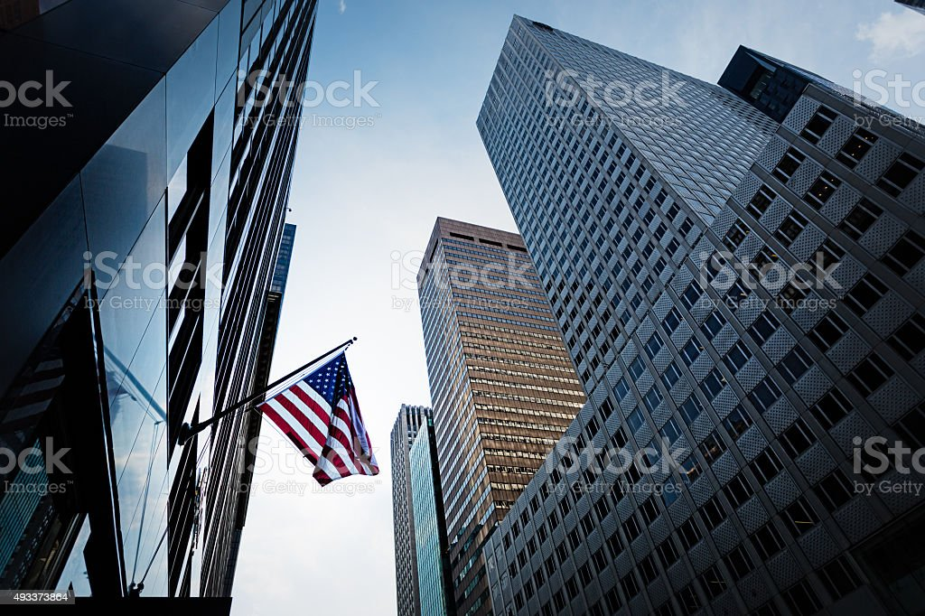 High rise buildings and US Flag stock photo