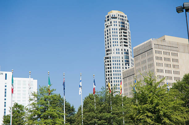 high rise in Atlanta Buckhead with national flags stock photo