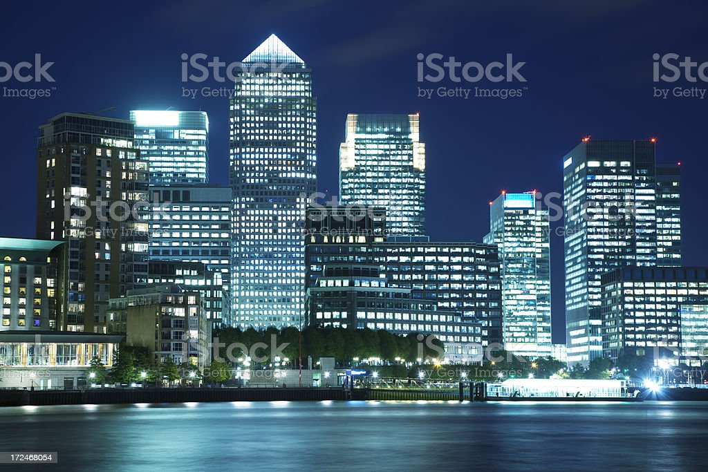 High Rise Office Buildings Illuminated at Night, Canary Wharf, London royalty-free stock photo