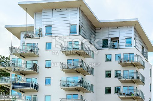 Karlshamn, Sweden - May 06, 2015: Top floors of modern high rise apartments with balconys in the centre of Karlshamn.