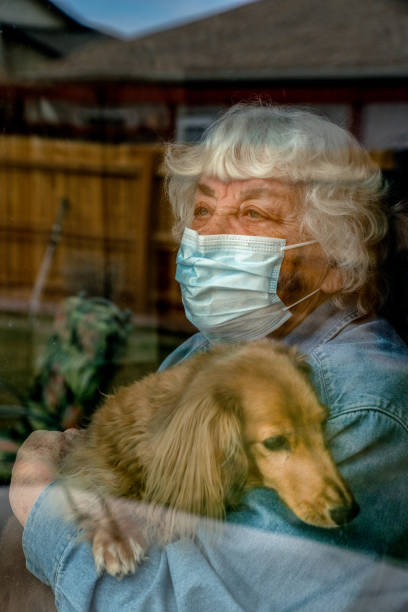 A High Risk Elderly Woman Quarantined In Her Home Because Of The Covid19, Corona Virus stock photo
