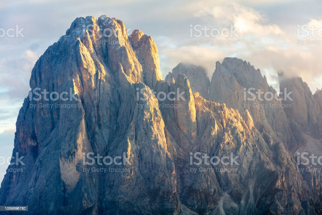 High rock peak in at sunset stock photo