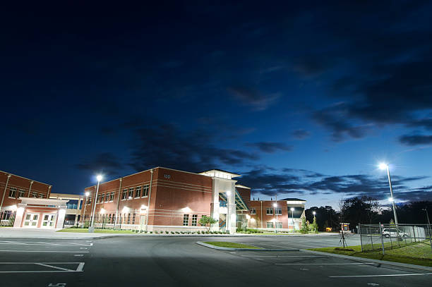 High School at Night High School at Night in Florida. high school building stock pictures, royalty-free photos & images
