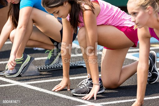 High school athletes at starting line for track meet race