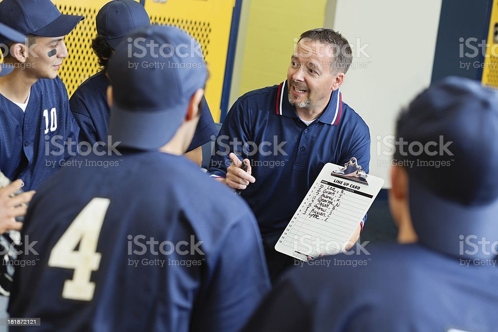 High school baseball coach with players/ locker room before game stock photo