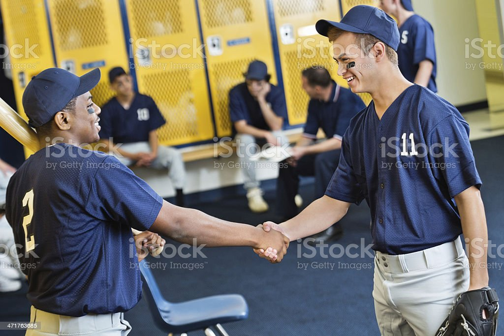 High school baseball players shaking hands after game stock photo