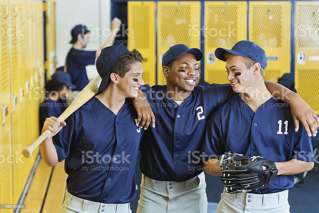 High school baseball team together in locker room after game stock photo