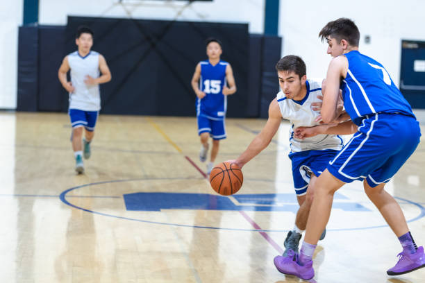 high school basketball game - high school sports stock pictures, royalty-free photos & images