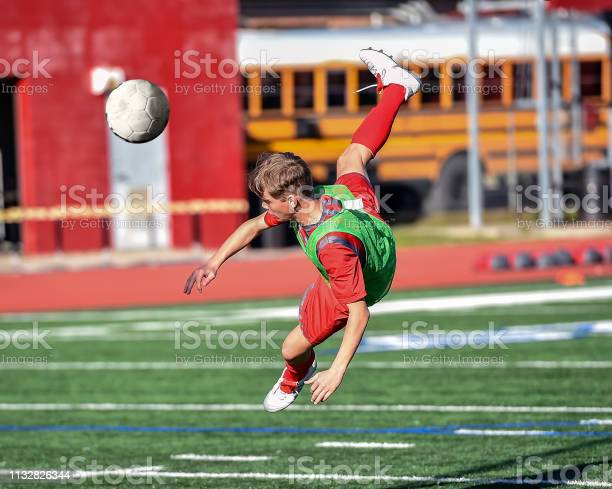 High school boy athlete making amazing plays during a soccer game picture id1132826344?b=1&k=6&m=1132826344&s=612x612&h=asilm8fo5lk5tiqdscoqb1eemqclmcumq79kfqbgn34=