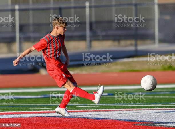 High school boy athlete making amazing plays during a soccer game picture id1132826542?b=1&k=6&m=1132826542&s=612x612&h=6ta ridd50bp 2li2msll2rodpdkz7o8ady2bkesazu=