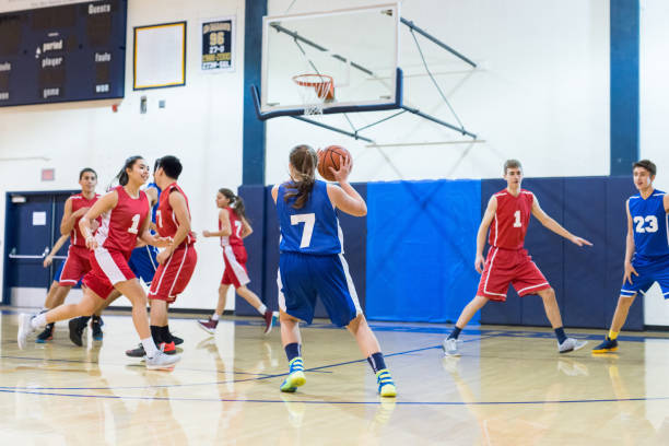 high school co-ed basketball game - high school sports stock pictures, royalty-free photos & images