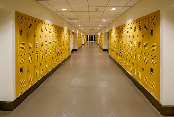 high school corridor with lockers - corridor stock photos and pictures