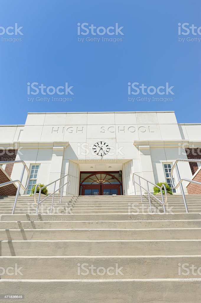 Steps leading up to high school entrance with copy space above.
