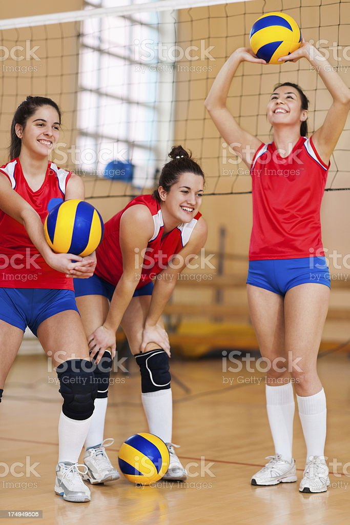 High school female volleyball team practicing. royalty-free stock photo