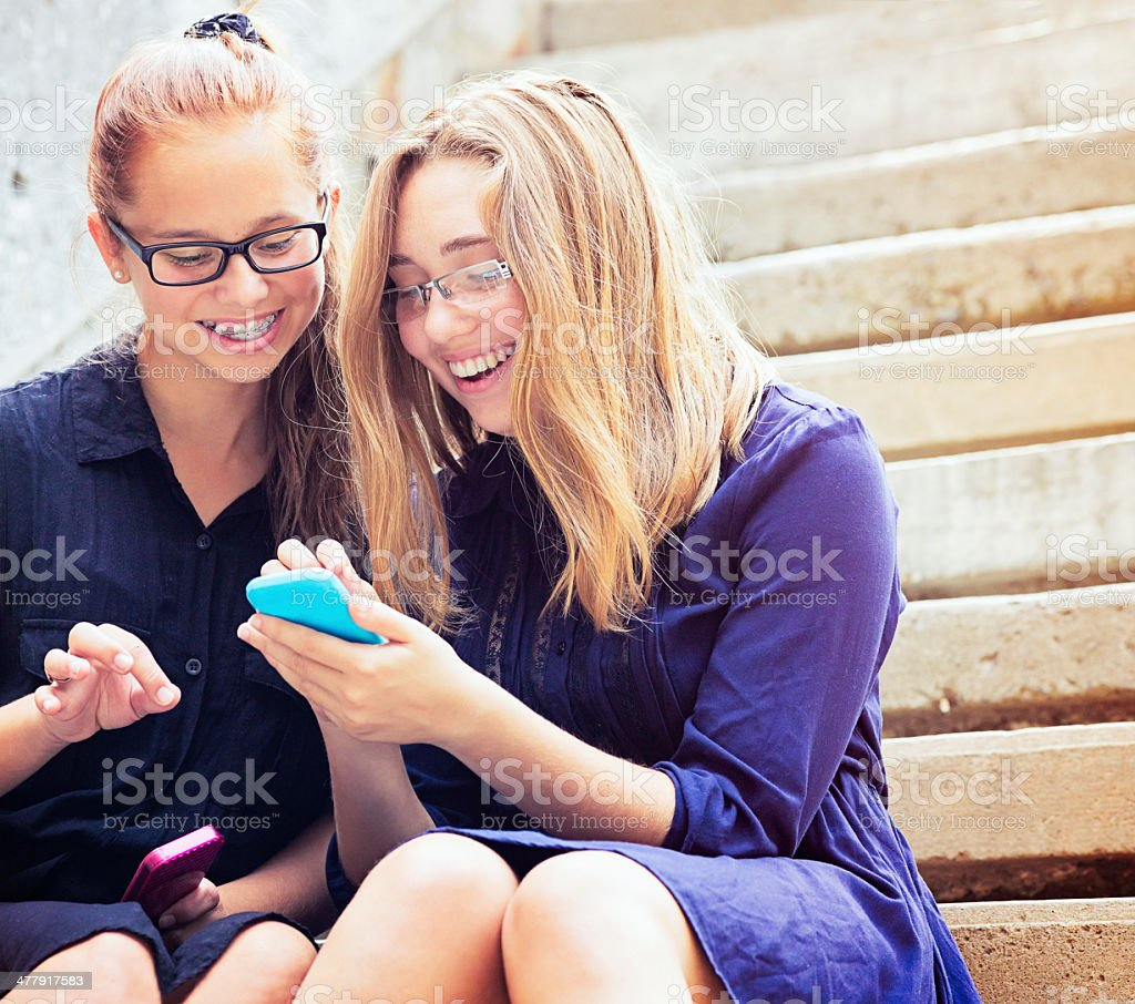 High School Friends having fun with mobile phone royalty-free stock photo
