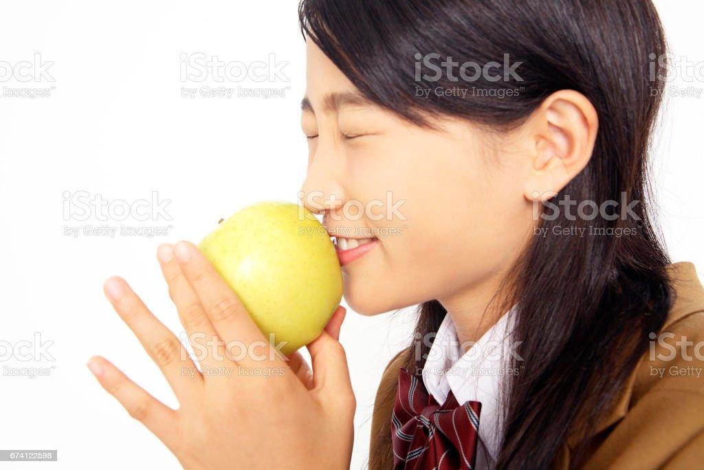 與蘋果公司的高中女生 免版稅 stock photo