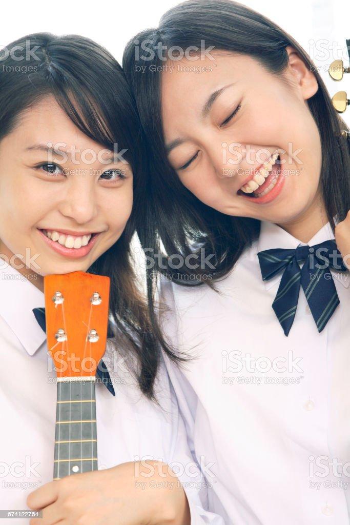 高中女生與夏威夷四弦琴 免版稅 stock photo