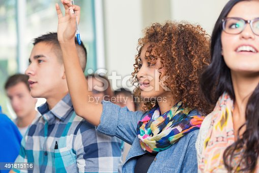 600055398 istock photo High school or college student raising hand to ask question 491815116