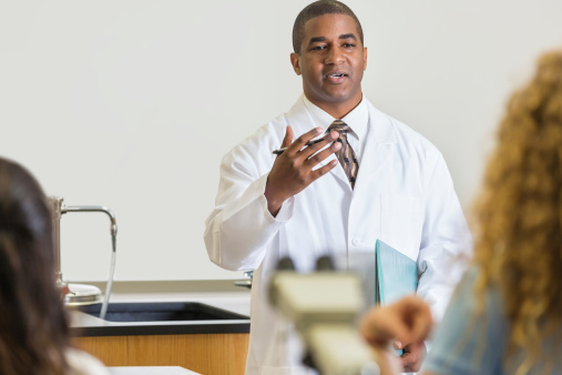 457224763 istock photo High school science teacher explaining experiment to students in classroom 498752435