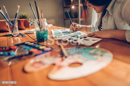 istock High school student doing homework 929313620