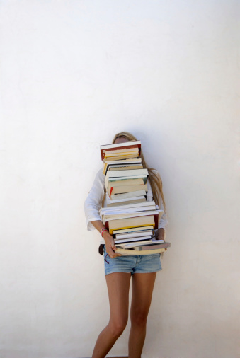 High School Student Holding Lots Of Books Stock Photo - Download Image Now