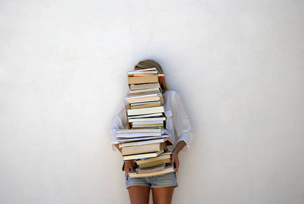 high school student holding lots of books - large group of objects stock photos and pictures