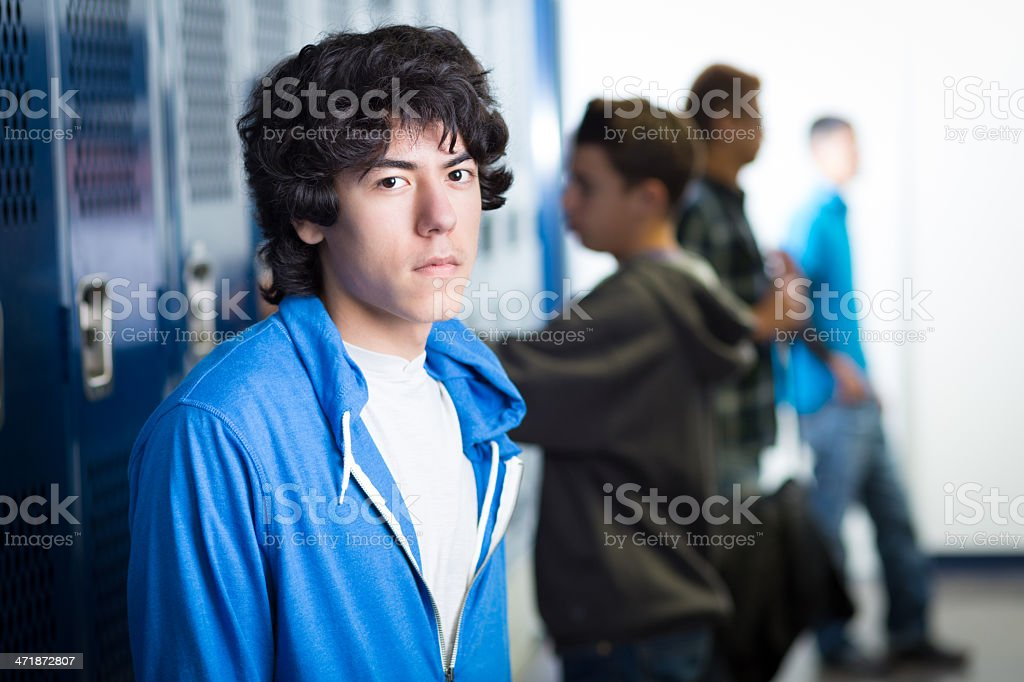 High school student in locker room after athletic gym class royalty-free stock photo