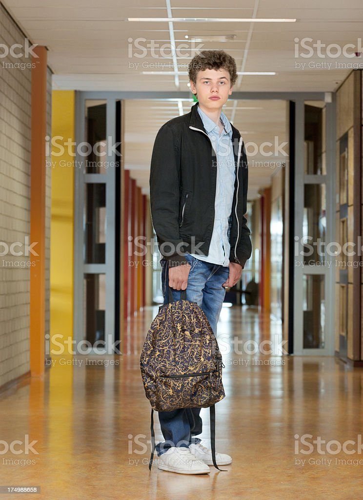 high school student standing in hallway royalty-free stock photo