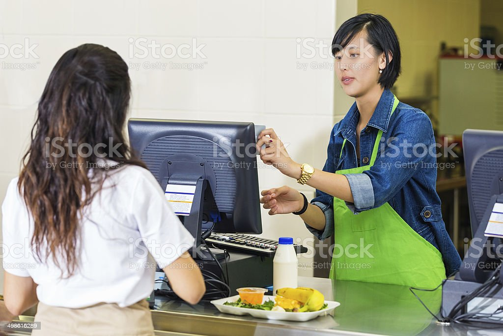 High school student using card to pay for cafeteria meal stock photo