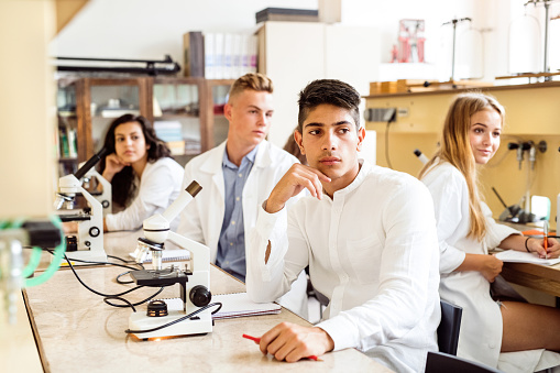 457224763 istock photo High school student with microscopes in laboratory. 841551078