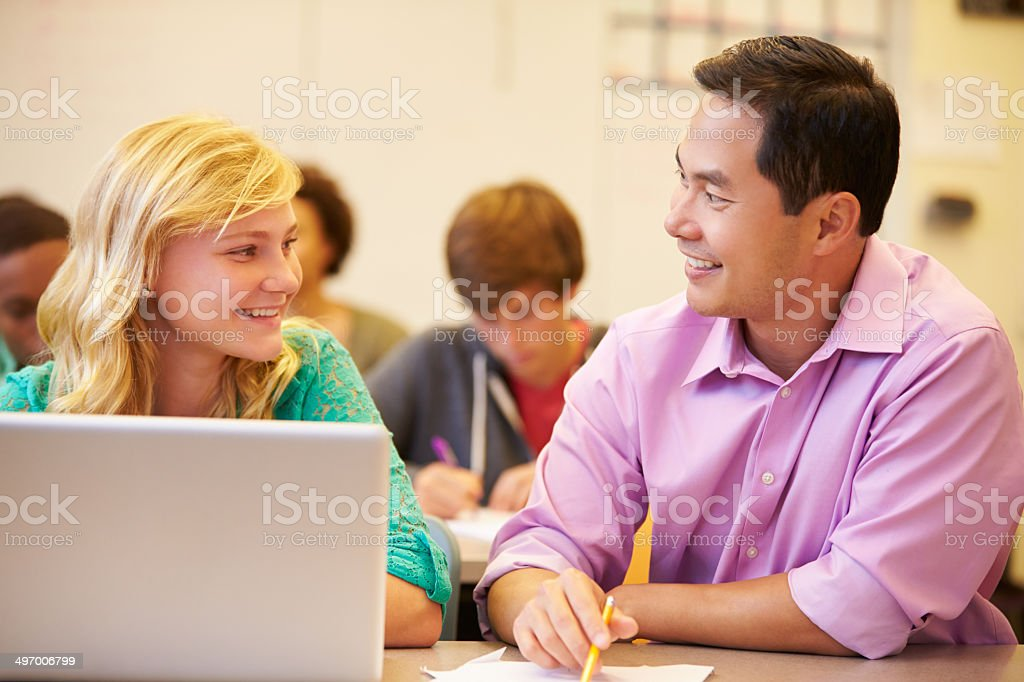 High School Student With Teacher In Class Using Laptop High School Student With Teacher In Class Using Laptop Smiling Assistance Stock Photo