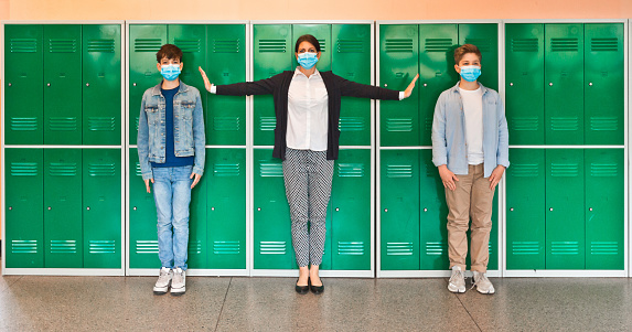High school students and teacher wearing N95 Face masks at school