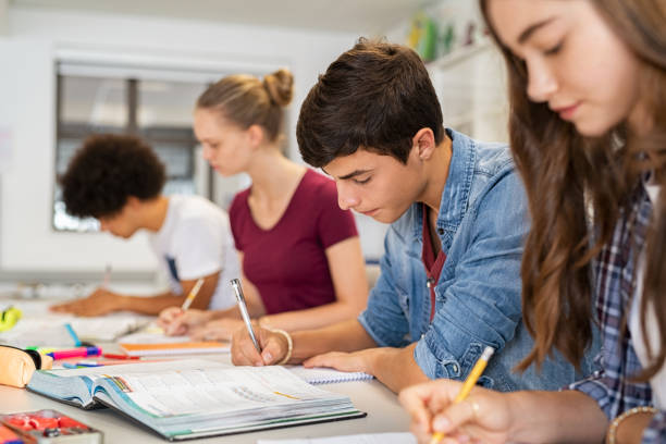 High school students doing exam in classroom stock photo