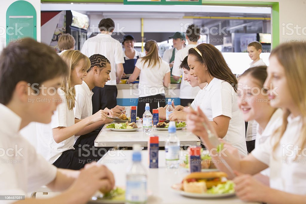 High School Students Eating In The Cafeteria stock photo