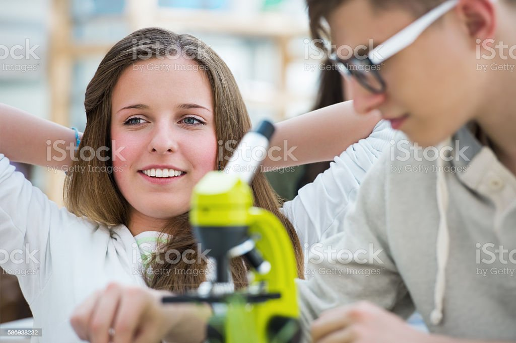 High School students. Group of excited students working in class stock photo
