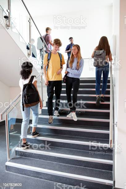 High school students walking on stairs between lessons in busy picture id1047529520?b=1&k=6&m=1047529520&s=612x612&h=jkyjcwd9hjerb3wnppgg zttz0uxhd3ja2o7hpsteew=