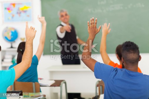 istock high school students with hands up in classroom 177605299