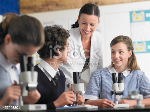 istock High School Students With Teacher in Chemistry Class 457226801