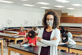 istock High School Teacher at School during COVID-19 1264747460